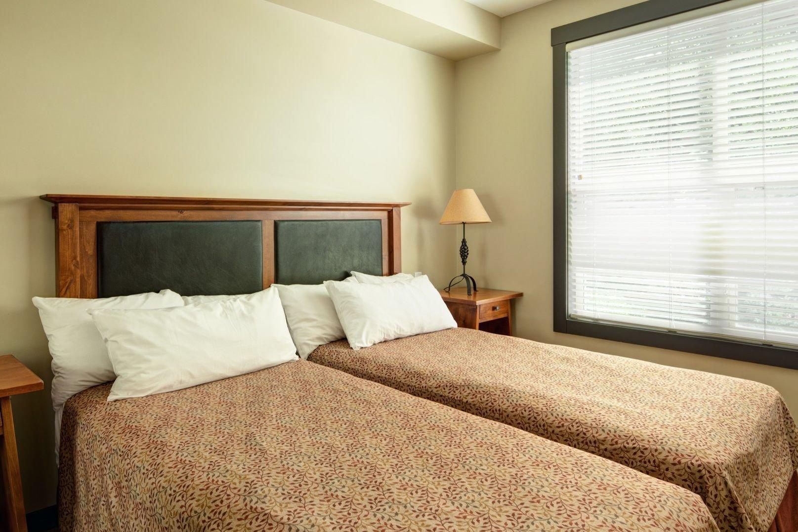 Panorama Mountain Village - Summit lodge bedroom.jpg