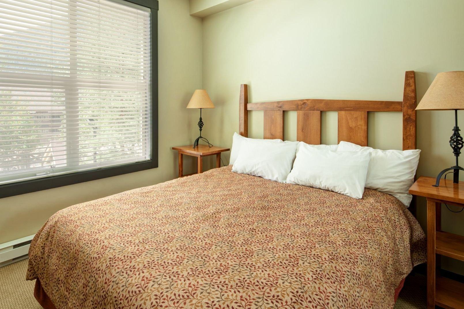 Panorama Mountain Village - summit lodge bedroom 2.jpg