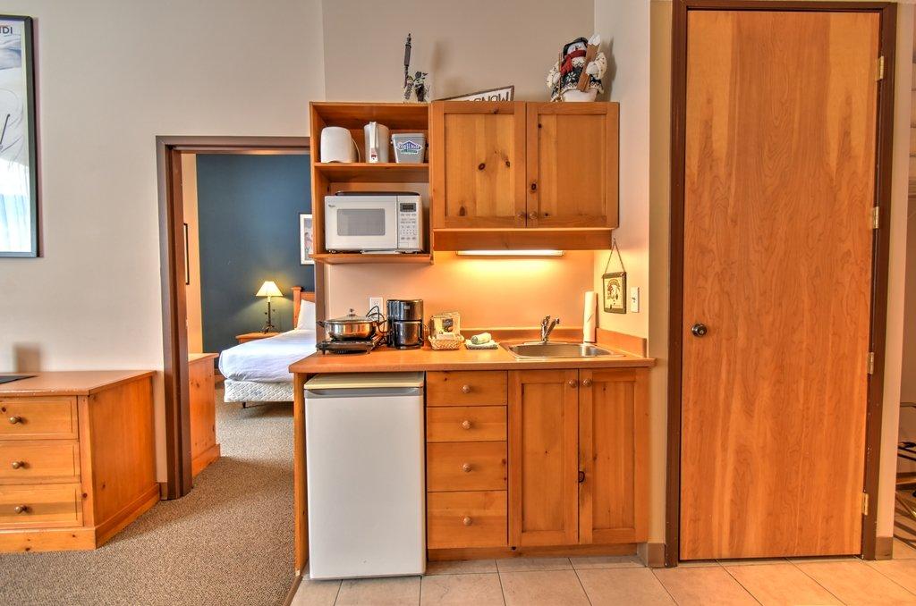 Big White - Inn at big white 1 bedroom living room.jpg